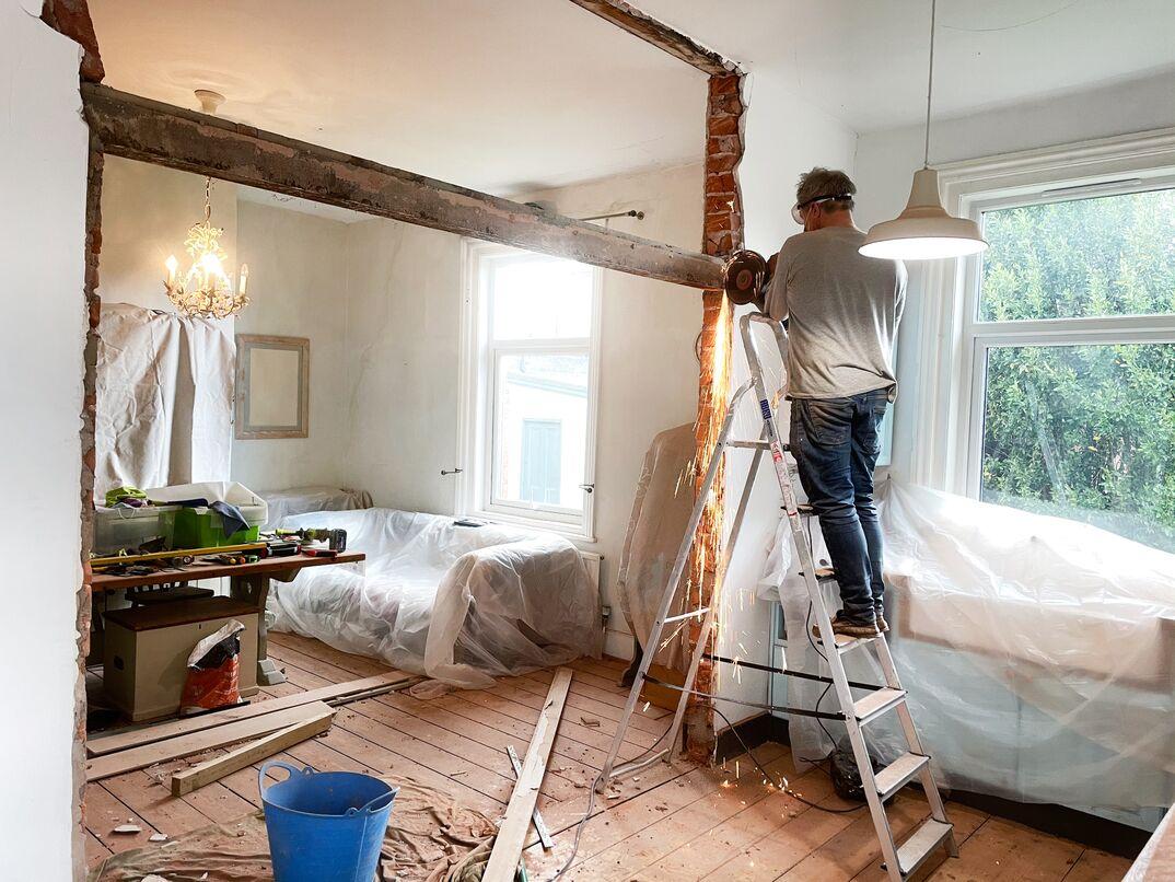 Man removing a metal beam