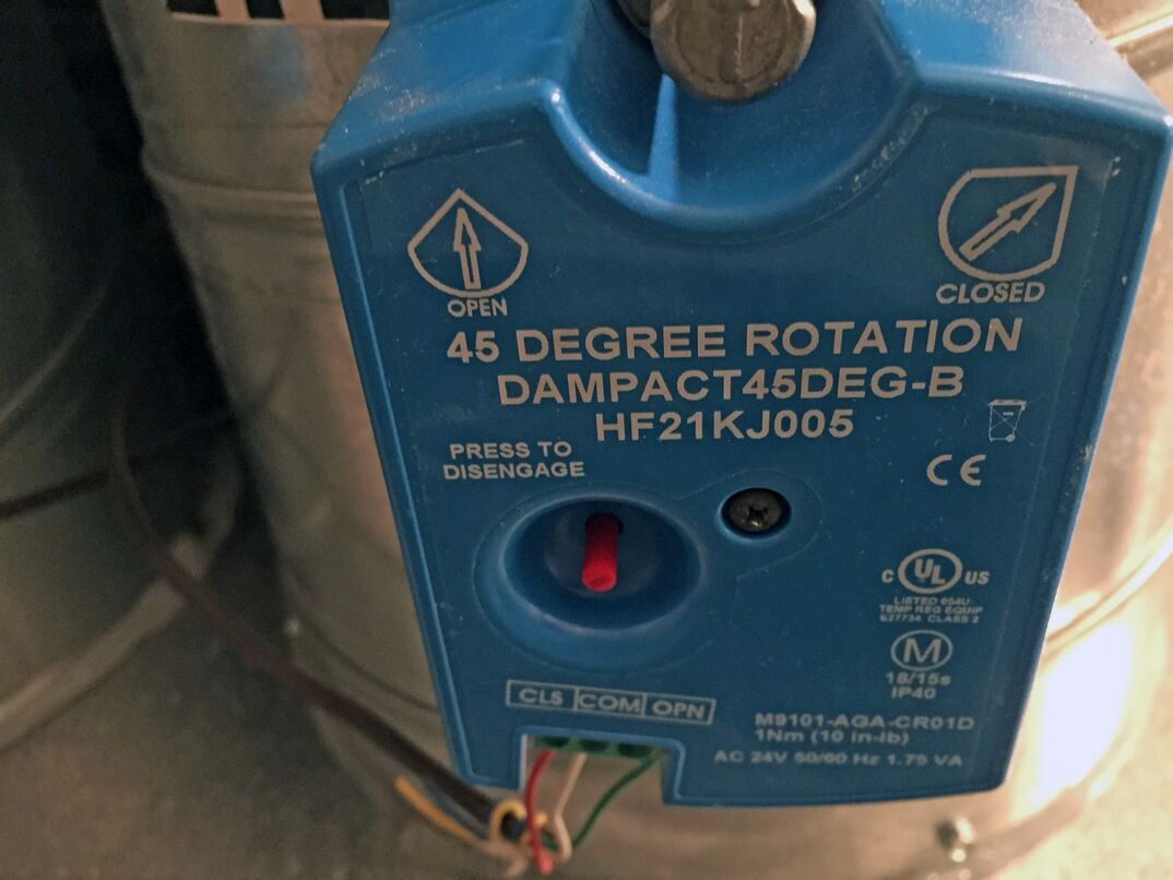 close up image of an blue module attached to hvac ductwork. The module reads 45 degree rotation