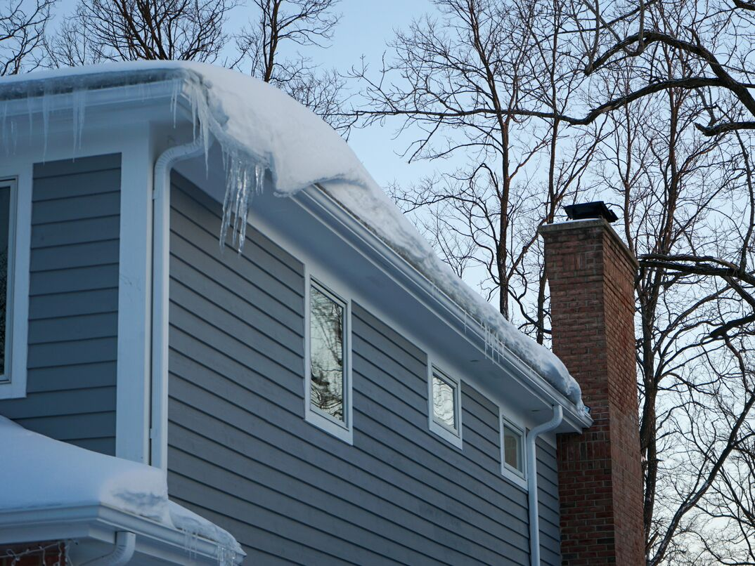 gutters covered in ice and snow