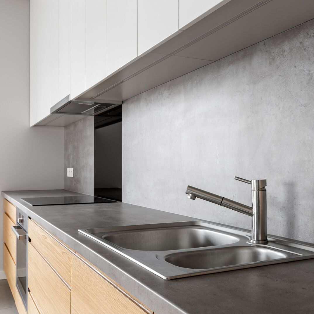 a modern kitchen showcasing a concrete counter top