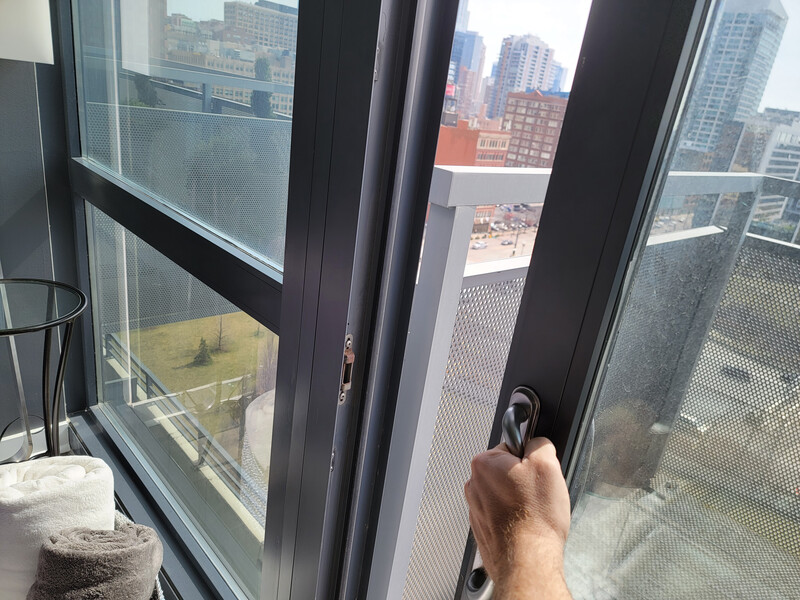 opening the window to a balcony