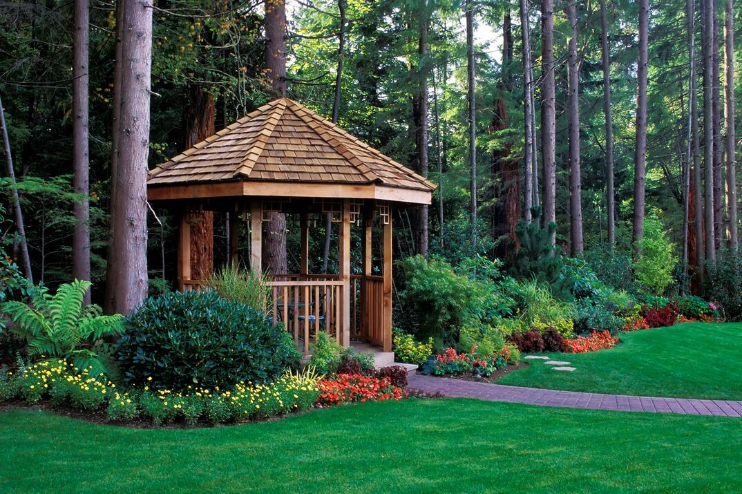 A beautiful backyard garden with a cedar wood gazebo