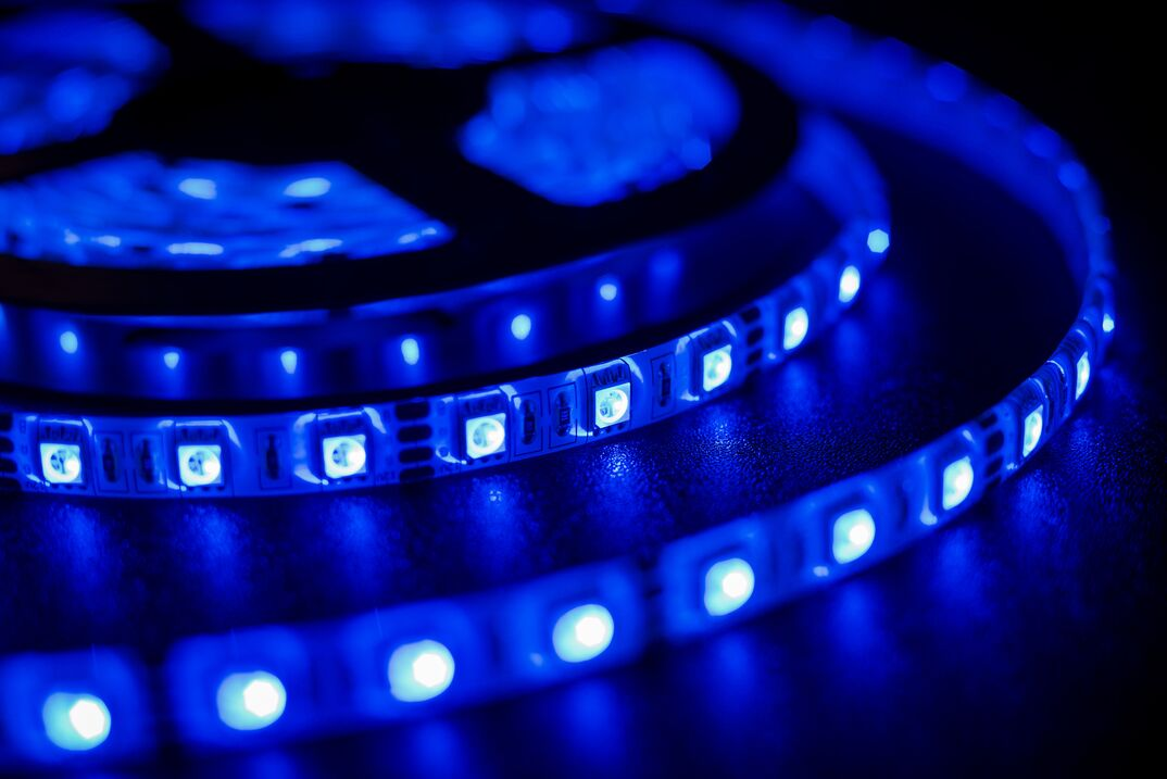 a coiled up and flexible blue LED light strip