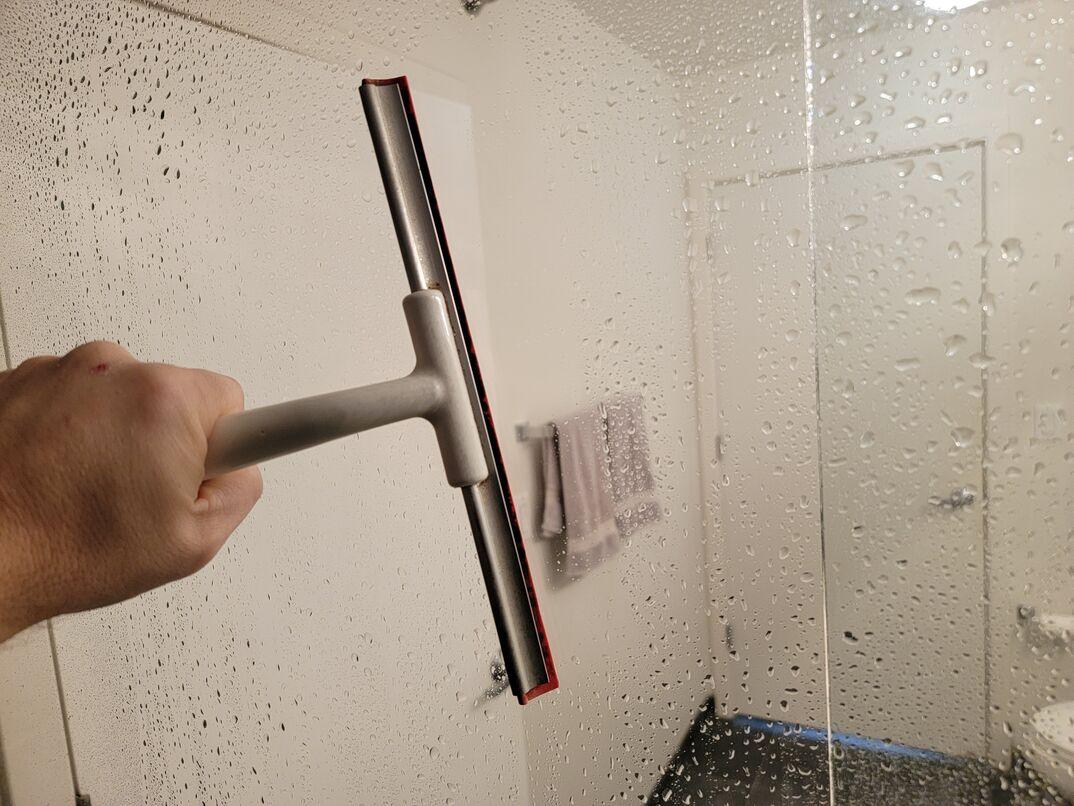 squeegeeing glass shower doors