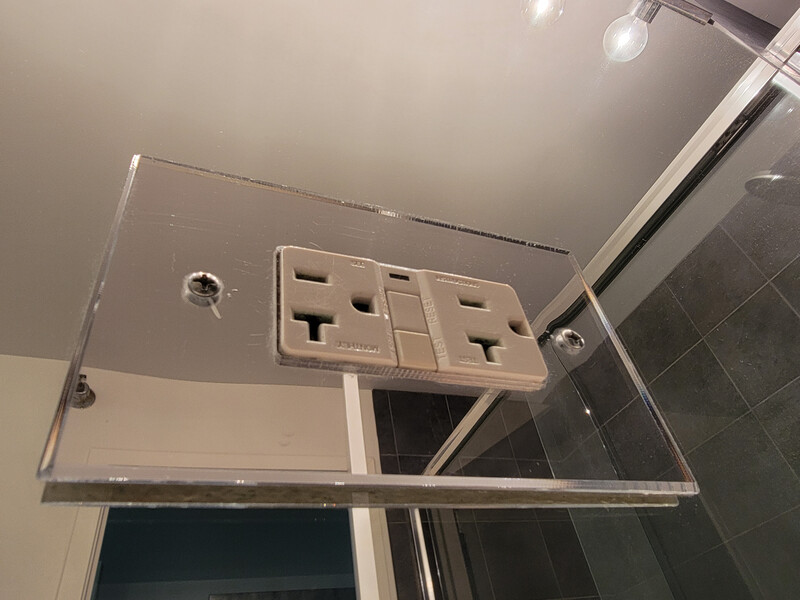 electrical outlet on glass wall