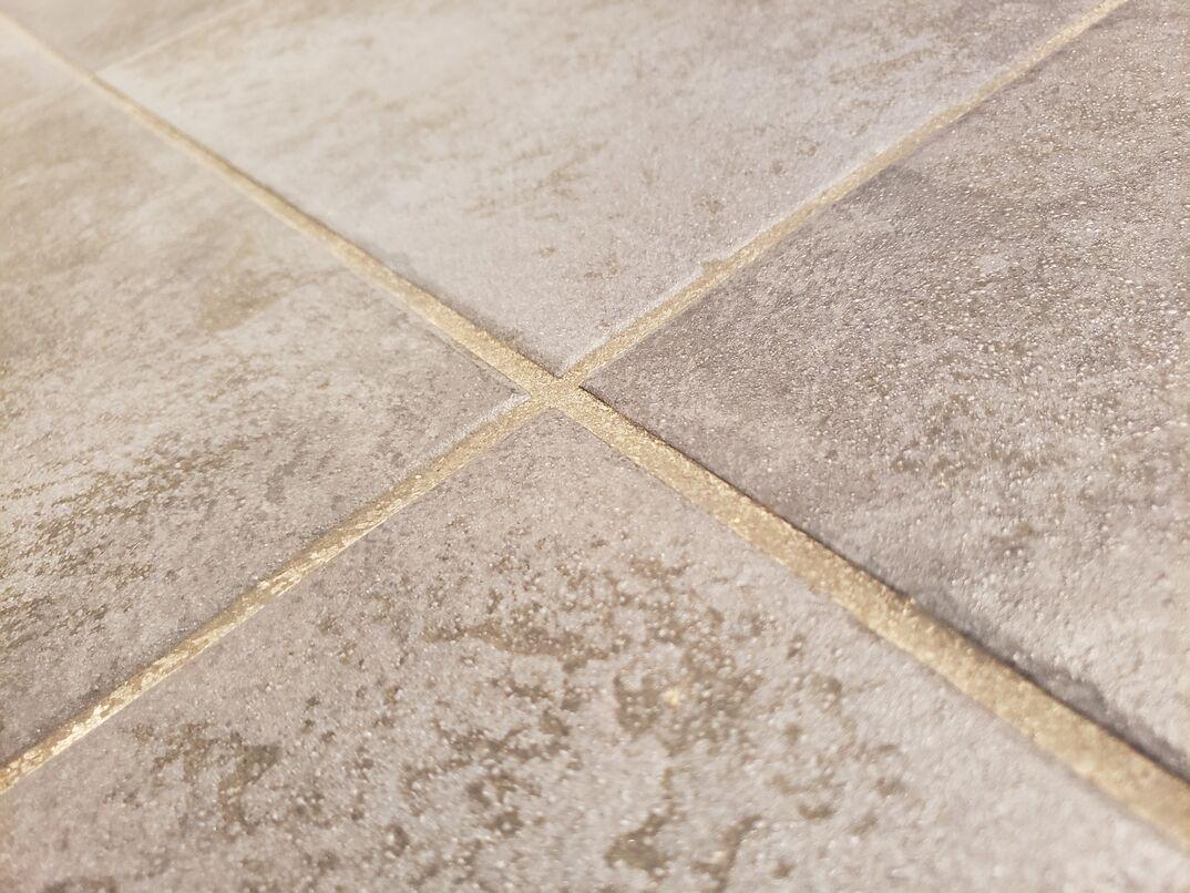 grout between tiles on the floor