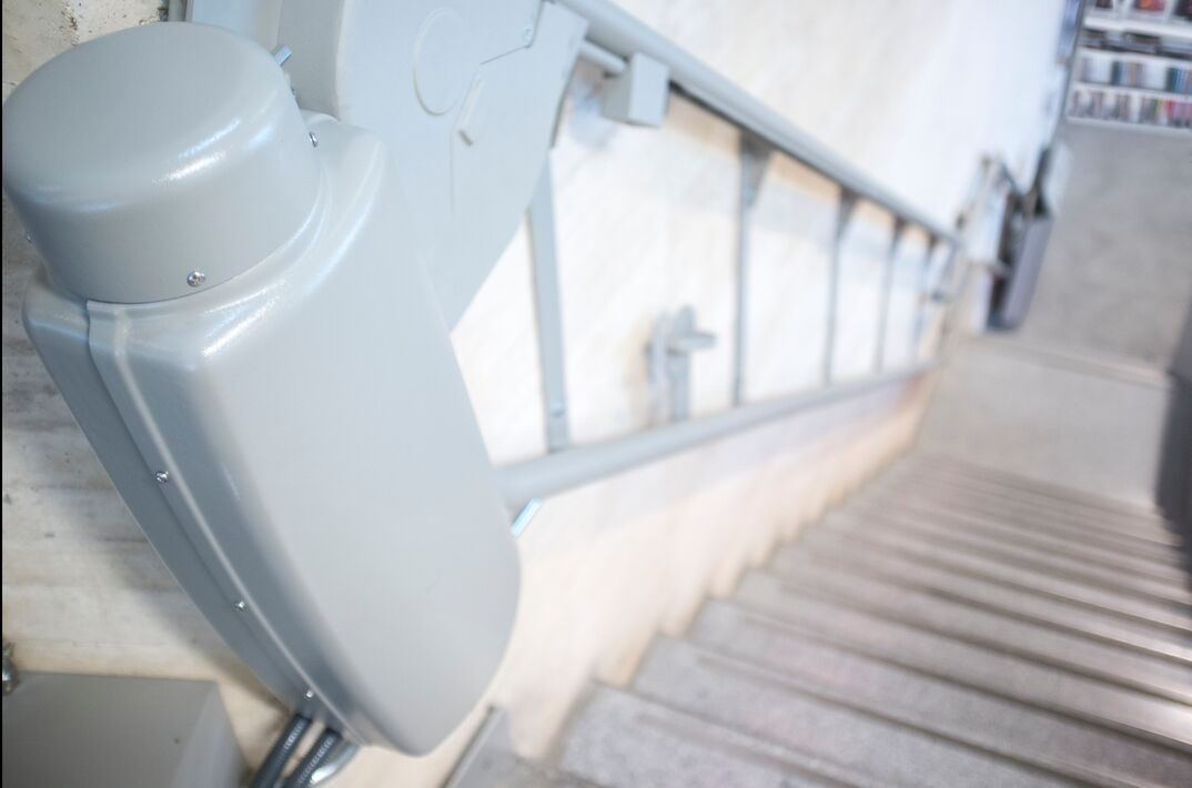 Chair lift for disabled and elderly people at library stairs