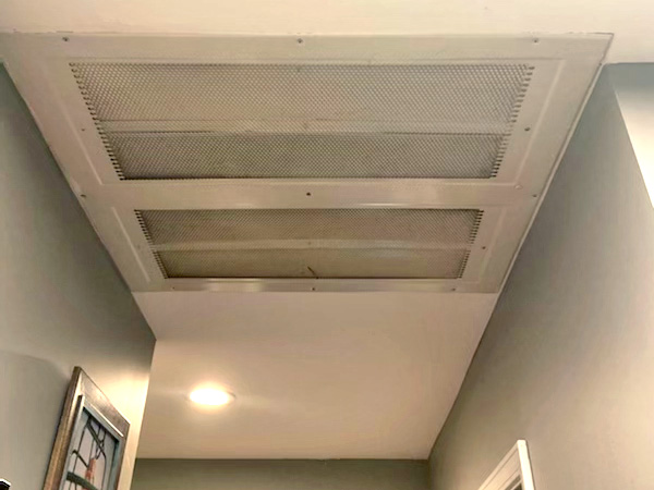 a worm s eye view of a residential whole house exhaust fan.