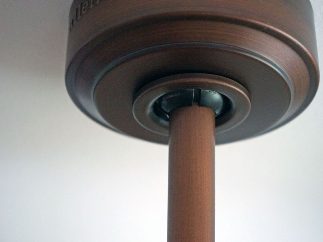 close up of a ceiling fan downrod