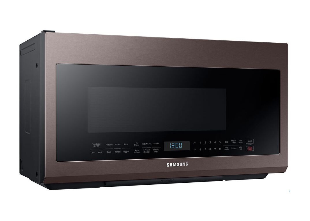 Dark-colored, gray and black Samsung microwave against white background.