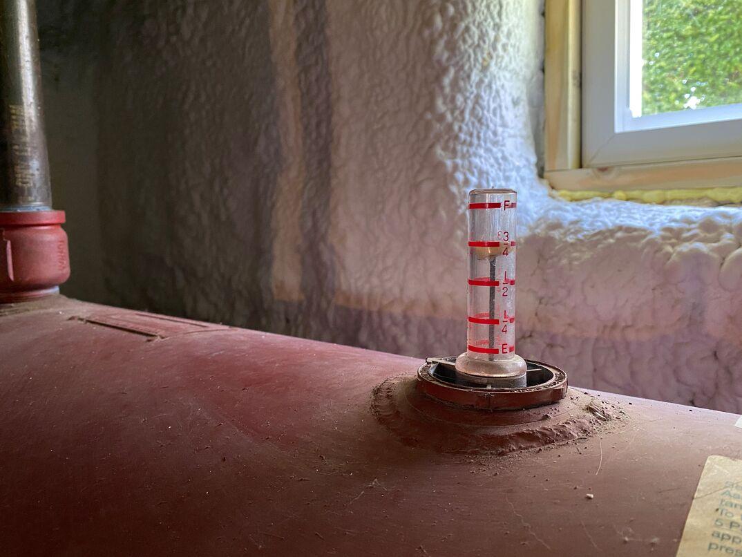 Oil heater tank in basement