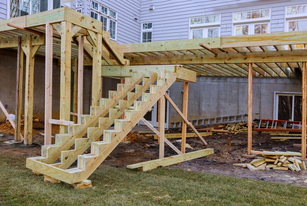 A photo of a residential deck during the framing part of the construction phase