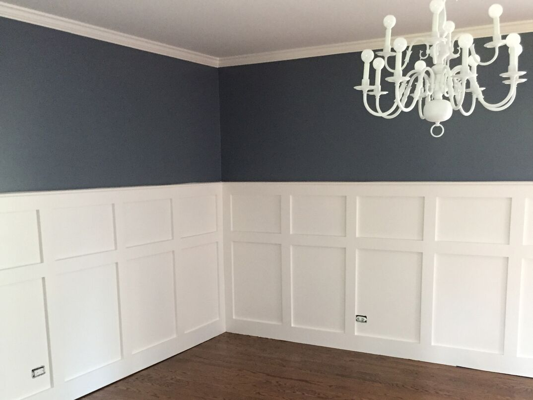 A formal dining room with finished Wainscoting