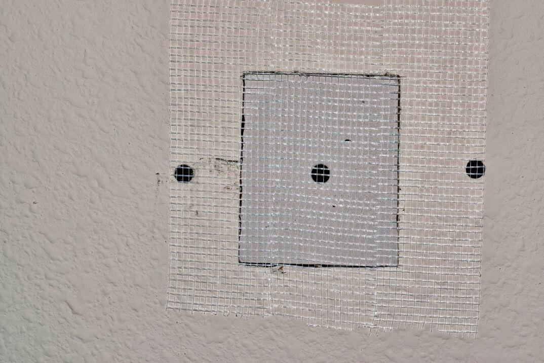 Drywall repairs in wall with fiberglass tape