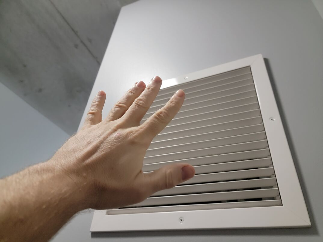 hand in front of air vent