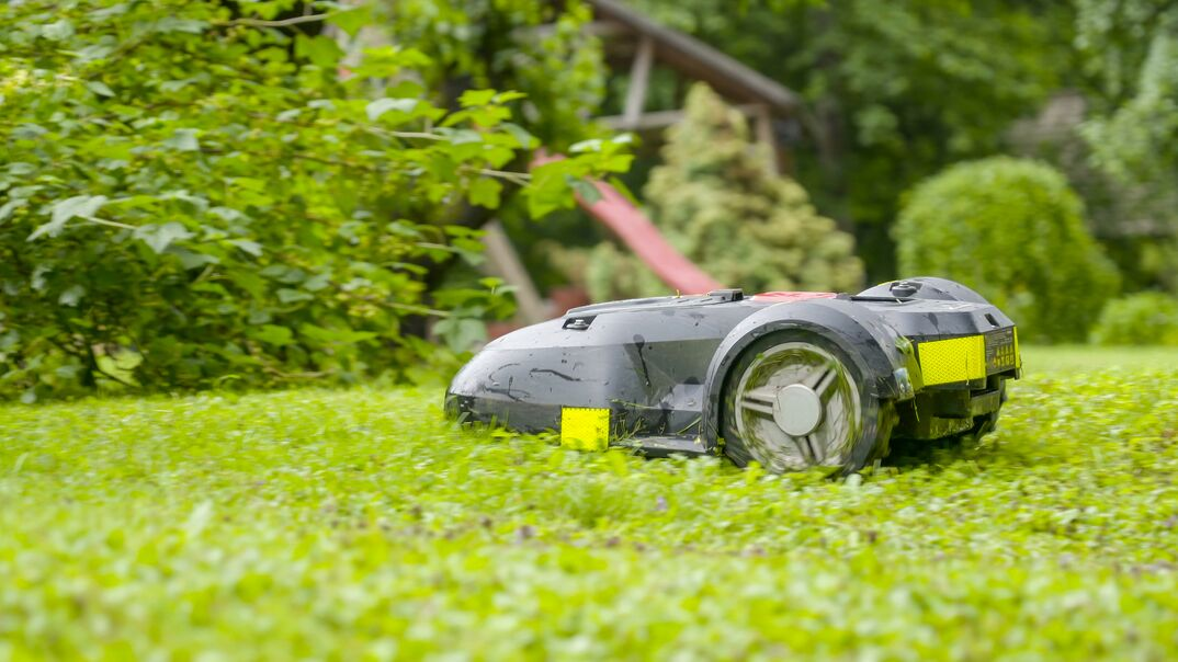 The moving automower on the green ground