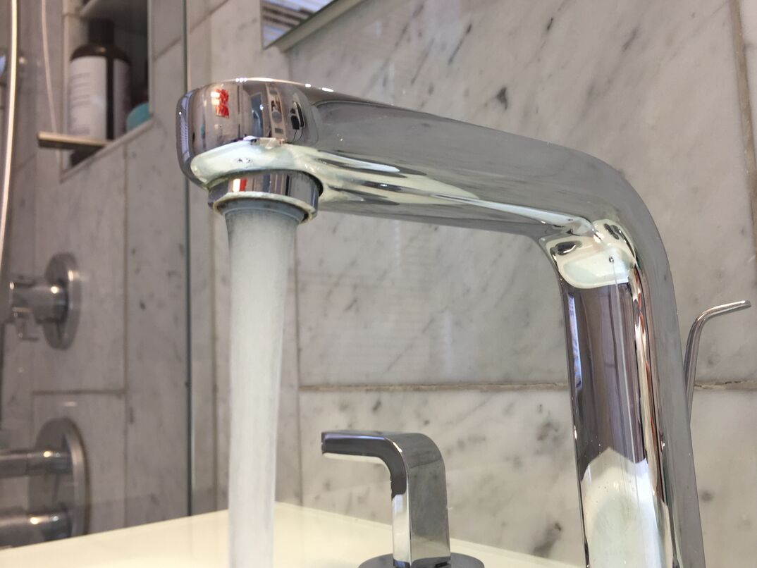 clean bathroom sink and faucet