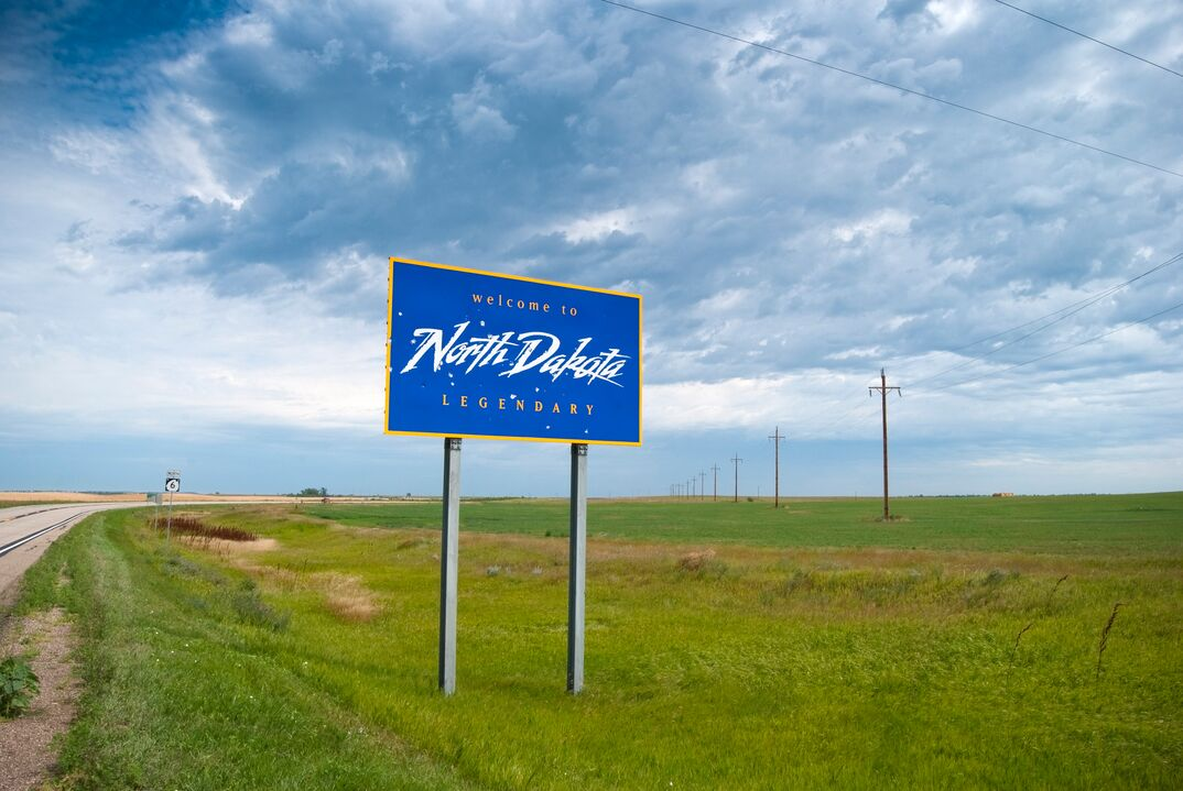 Welcome to North Dakota sits besides a highway