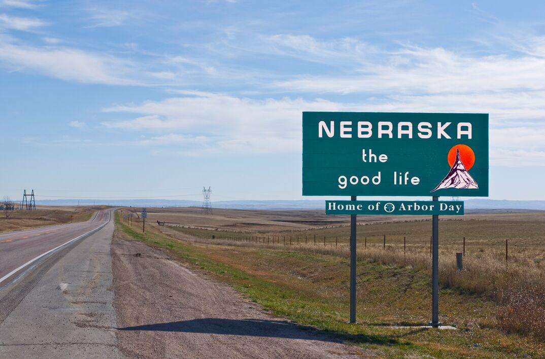 Welcome to Nebraska sign alongside a quiet highway