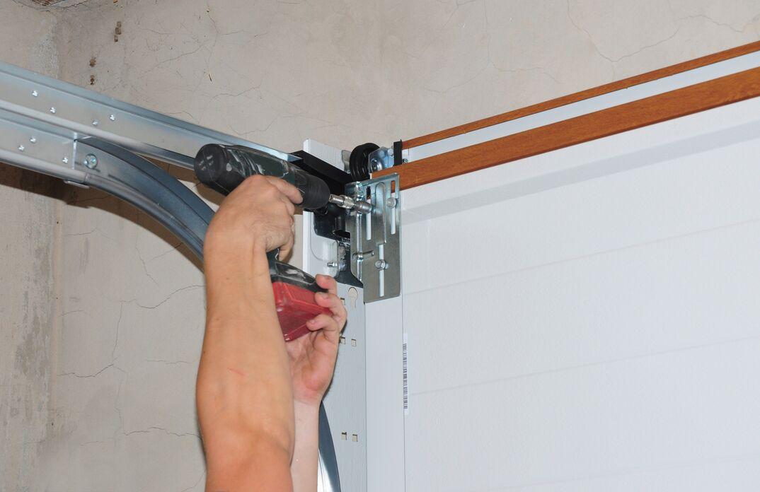 Repairman repair garage door opener  Garage door replacement, garage door repair