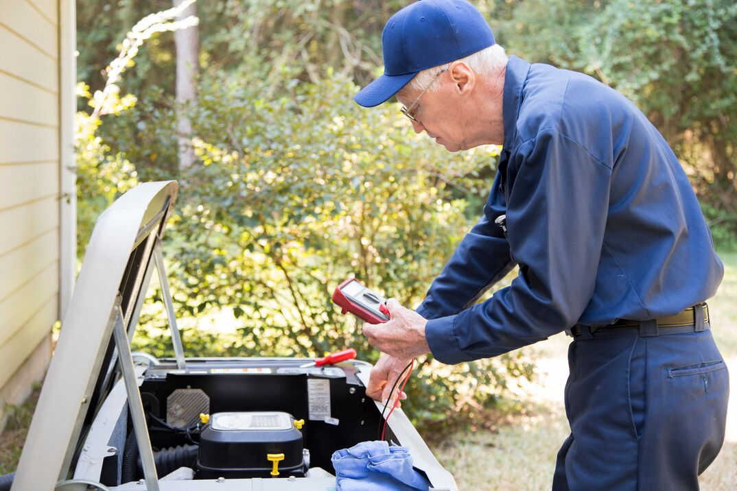 Technician services outside AC units and generator