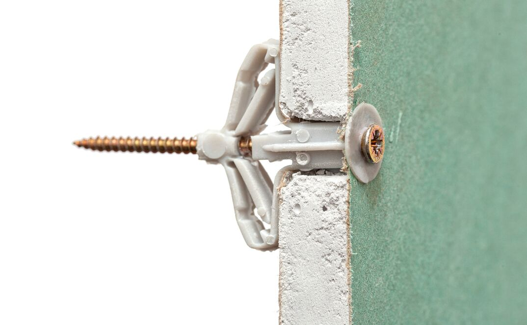a cut-away image of a drywall anchor depicting how it works