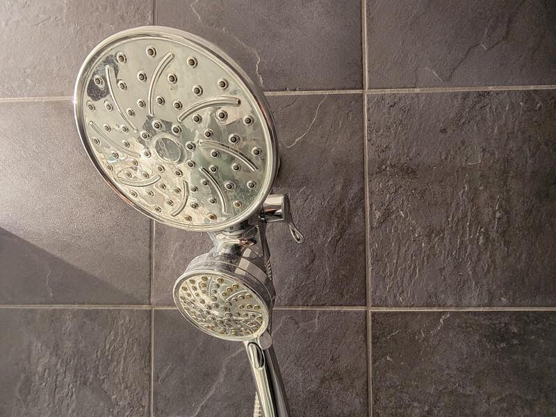 Showerhead with handheld sprayer