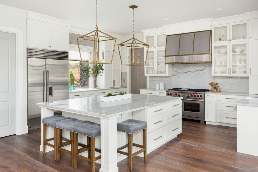 beautiful kitchen in new luxury home with a Marble island