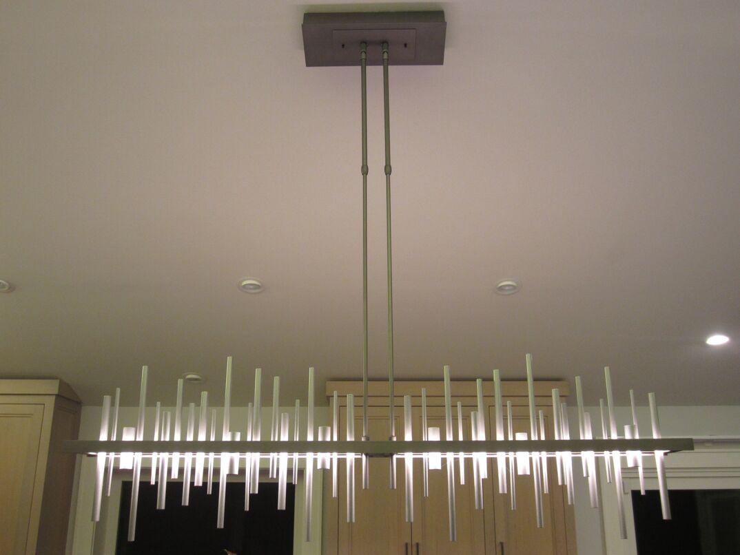 Lights chandelier fixture over kitchen island