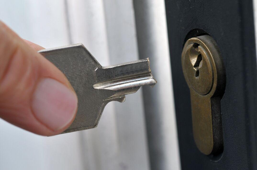 Broken key in front of a lock